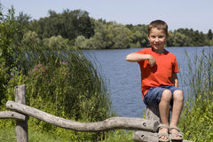 Child points the finger at himself Stock Image