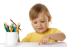 Child points on his drawing Stock Photo