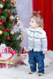 Child points his finger on a Christmas tree Royalty Free Stock Photos