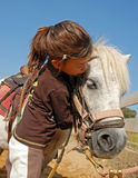 Child and pony Stock Photography