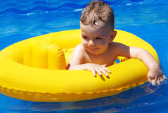 Child in the pool Royalty Free Stock Photos