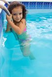 Child in the Pool. Child holding in border of the pool Stock Photography