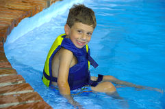 Child in a Pool. Young Boy Sitting in a Pool Stock Images