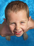 Child in pool. Boy in a swimming pool looking up Royalty Free Stock Photography