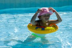 Child in the pool Royalty Free Stock Image