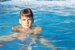 Child in the pool Stock Photos