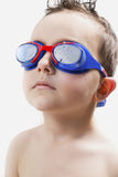 Child in the pool with goggles Royalty Free Stock Images