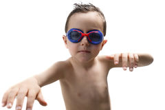 Child in the pool with goggles Royalty Free Stock Photo