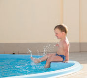 Child in the pool Stock Image