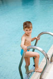 Child in the pool Stock Photo