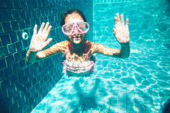 Child in the pool underwater Stock Photo