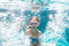 Child in the pool underwater Royalty Free Stock Images