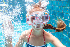 Child in the pool underwater Stock Images