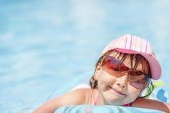 Child in pool stock photo