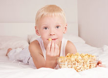 Child with popcorn Stock Images