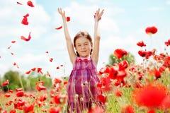 Child at poppy field Stock Photo