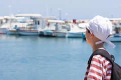Child  in port or harbor Royalty Free Stock Image
