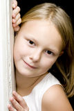 Child portrait. Portrait of a smiling little girl with blond hair Stock Image