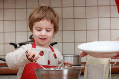 Child portrait. Smiling boy, playing in the kitchen Royalty Free Stock Photos