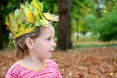 Child portrait in autumn forest Stock Photo