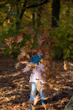 Child portrait in autumn park. No face. Royalty Free Stock Photo