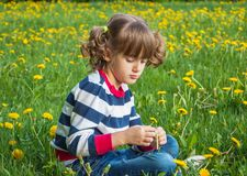 Child portrait on the background of dandelions Royalty Free Stock Photography