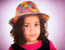 Child portrait. Portrait of beauty little girl with colorful hat royalty free stock image