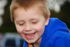 Child portrait. Portrait of little happy, blonde boy royalty free stock images