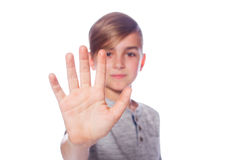 Child portrait, nine years old schoolboy showing numbers five wi Royalty Free Stock Photo