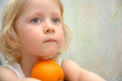 Child portrait with orange fruit Stock Images
