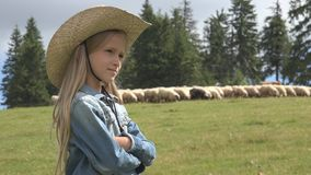 Child Portrait on Pasture, Farmer Girl and Grazing Sheep, Kid Shepherd in Field.  stock image