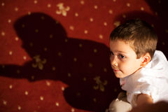 Child portrait with shadow Stock Photography