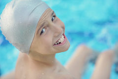 Child portrait on swimming pool Stock Photos