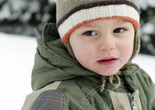 Child portrait in winter snow Royalty Free Stock Photos