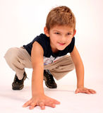 Child pose. Child in strange pose royalty free stock photography