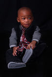 Child posing with funny expression. African American boy posing with cute funny expression stock image