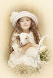 Child posing with her pet goat Stock Image
