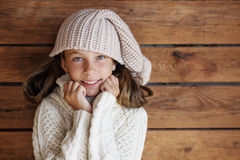 Child posing in knitted clothing Stock Photo
