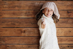 Child posing in knitted clothing Stock Images