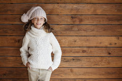Child posing in knitted clothing Royalty Free Stock Photo
