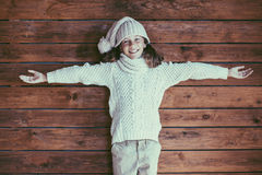 Child posing in knitted clothing Stock Image