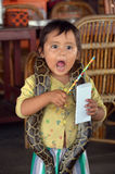 Child posing with a python Royalty Free Stock Photography