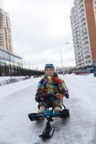 Child posing on snow scooter Royalty Free Stock Image