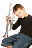 Child Posing With Trumpet. Isolated Child Posing With Trumpet royalty free stock images