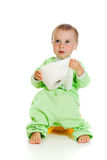 Child on potty play with toilet paper. Isolated over white royalty free stock image