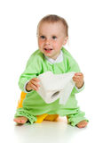 Child on potty play with toilet paper. Isolated over white stock photography