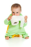 Child on potty play with toilet paper. Isolated over white royalty free stock images