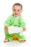 Child on potty play with toilet paper. Isolated over white stock photo