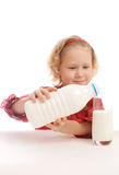 Child pouring milk Stock Image