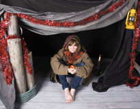 Child in poverty. A young child in a shelter at xmas royalty free stock photography